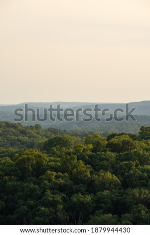 Sunset looking over the tree canopy.  Shawnee National Forest, Illinois. Royalty-Free Stock Photo #1879944430