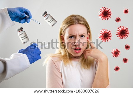 Covid-19 vaccination concept, young woman being forced to take Coronavirus vaccine shot. Also, fear of vaccination and conspiracy theory  Royalty-Free Stock Photo #1880007826