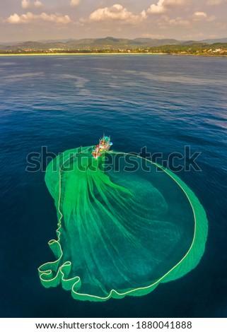 Ships and fishermen are fishing anchovies in Yen Island, Phu Yen, Vietnam Royalty-Free Stock Photo #1880041888