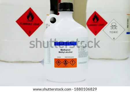 Bottle of Methanol, methyl alcohol, MeOH with Properties information and Variety type of chemical containers with its chemical hazard warning symbols. Flammable warning symbol, Toxic warning symbol. Royalty-Free Stock Photo #1880106829
