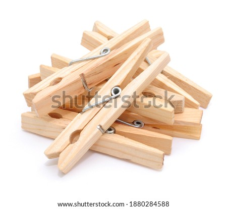 Wooden clothespins on white background, isolated. Royalty-Free Stock Photo #1880284588