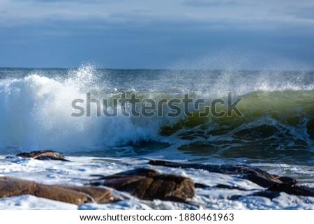 Ocean Waves Crashing on Rocks Royalty-Free Stock Photo #1880461963