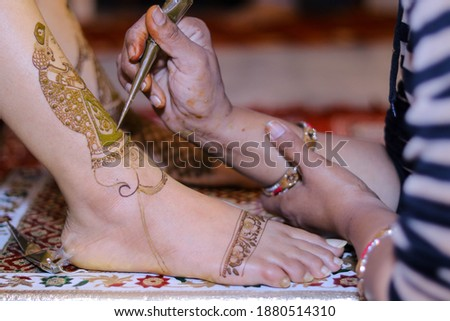 Picture of mehndi work on Bride leg at her wedding ceremony. Beautiful mehndi picture. Selective focus concept.