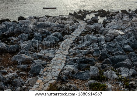 Limeni, Peloponesse, Greece - December 227, 2017: Alley to the sea #1880614567