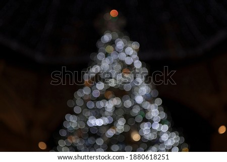 Christmas decorations blurred to produce bokeh balls background. Royalty-Free Stock Photo #1880618251