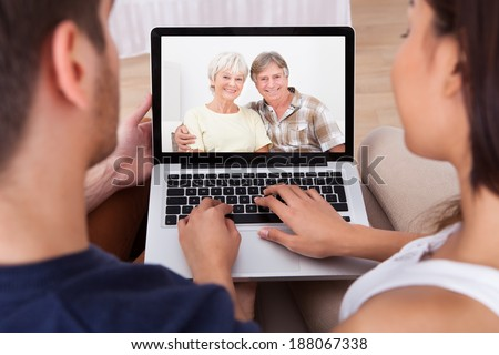 High angle view of young couple videocalling parents at home #188067338
