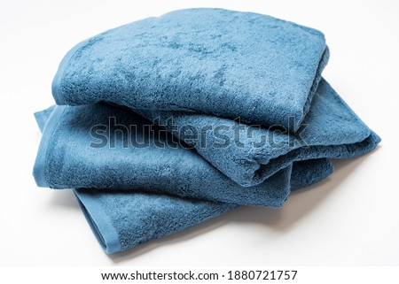 Blue bath towel taken on a white background Royalty-Free Stock Photo #1880721757