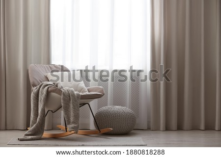 Beautiful curtains on window in stylish room interior Royalty-Free Stock Photo #1880818288