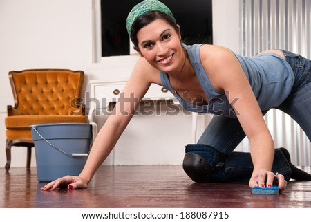 A woman tries to make fun out of cleaning the floor by hand #188087915