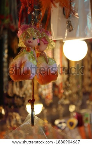 Doll keychain a small-scale figure of a human being used especially as a child's plaything clicked at toyshop Royalty-Free Stock Photo #1880904667
