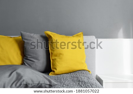 illuminating yellow ultimate gray colored pillows on bed Trendy 2021 colors years Modern interior design Cozy textile Sweet home Royalty-Free Stock Photo #1881057022