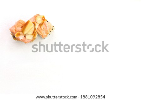 two sushi rolls on the white background isolated. seafood Japanese food with salmon. copy space. text space sushi