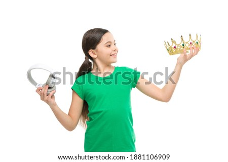 queen of music. portrait of cheerful girl isolated on white. happy childhood. small girl choose between crown and headphones. being a super star. best hit list. royalty free music. pop princess.
