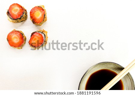 set of sushi rolls with salmon avocado and strawberry on the white background isolated with soya sauce. delicious Japanese dishes with copy space text.