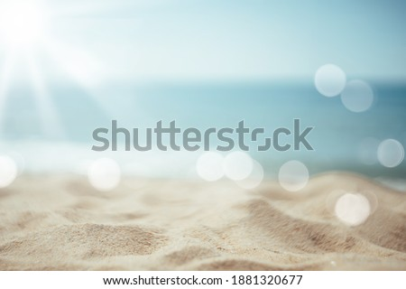 Copy space blur tropical beach with bokeh sun light wave on blue sky and white cloud abstract background. Summer vacation outdoor and travel holiday adventure concept. Vintage tone filter effect color Royalty-Free Stock Photo #1881320677