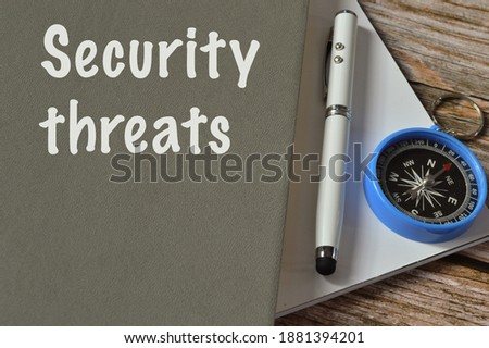 Selective focus with noise effect of pen, compass and notebook written with text SECURITY THREATS.  Royalty-Free Stock Photo #1881394201