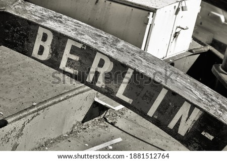 Marking the home port of a ship with the lettering Berlin. The decommissioned barge is located on the Fischerinsel in Berlin.