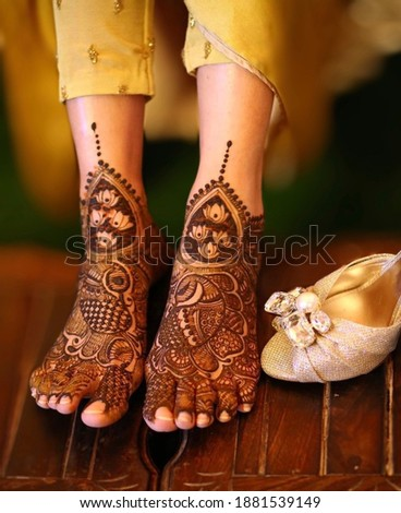 In this picture bride mehndi has shown (selectively focused)