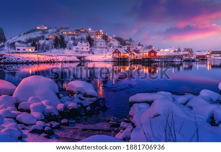 Amazing evening on Lofoten. Scenic photo of winter fishing village and colorful sky. stunning natural background. Picturesque Scenery of Reinefjord one most popular place of Lofoten islands. Norway Royalty-Free Stock Photo #1881706936