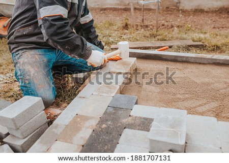 Bonding granite tiles to concrete subfloors outside the house - porch and patio cladding Royalty-Free Stock Photo #1881707131