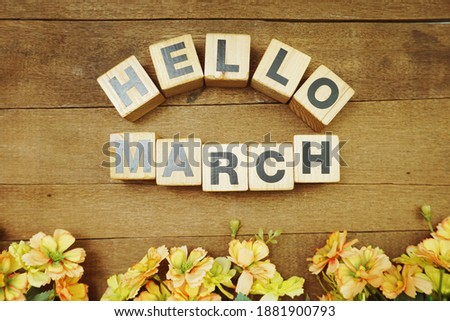 Hello March alphabet letters on wooden background