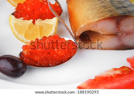 diet food - red caviar and smoked mackerel fish with lemon tomatoes and bread on white china plate isolated over white background #188190293