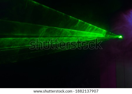 Green lasers for show in smoke Royalty-Free Stock Photo #1882137907