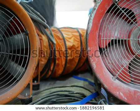 closeup of exhaust fan or portable ventilation fan at construction site.