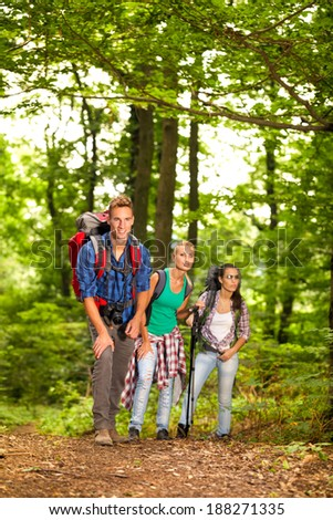 friends having fun hiking through the forest #188271335