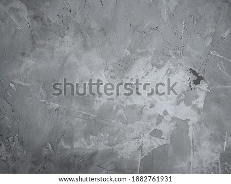 Tile or stone surface in neutral gray colors. Art cement and concrete texture background. Plastered concrete wall, rough building material of grey trendy color. Trend color 2021 - Ultimate Gray.