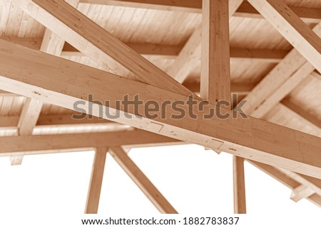 Wooden roof construction. Rafters and roof beams close-up. Royalty-Free Stock Photo #1882783837