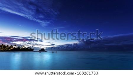 Starry night on Maldives, dark blue night sky over beach resort, beautiful nighttime seascape, luxury summer vacation and tourism concept  #188281730