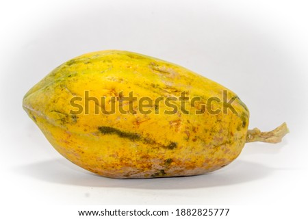 healthy papaya isolated on white background. image contains some noise with sharpening