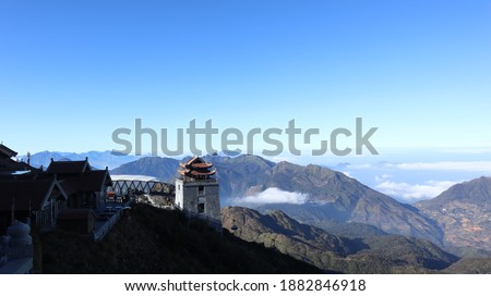 """On Fansipan peak. It is the highest mountain in the Indochinese Peninsula (comprising Vietnam, Laos, and Cambodia), hence its nickname """"the Roof of Indochina"""". Royalty-Free Stock Photo #1882846918"""