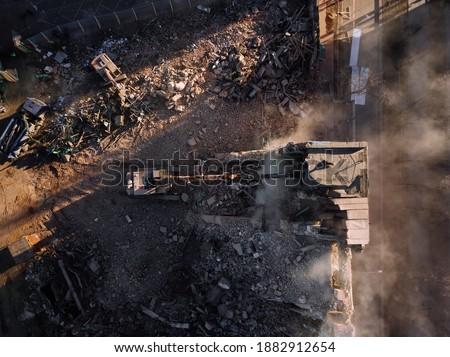 Aerial view of demolition site. Process of demolition of old industrial building Royalty-Free Stock Photo #1882912654