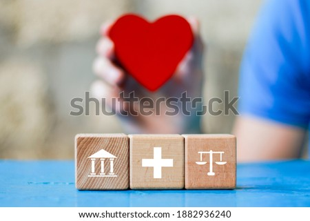 Doctor hand arranging wood block stacking with icon justice healthcare Labor Law Lawyer. Legal Concept medical.