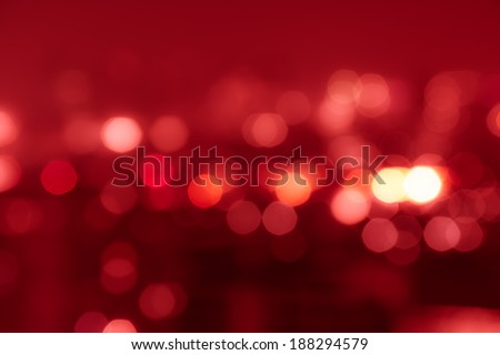Red tone blur bokeh light. Defocused  background. Royalty-Free Stock Photo #188294579