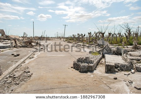 Abandoned city. City abandoned by a flood, in a peculiar ghost town. ruined houses. Desolate landscape. Royalty-Free Stock Photo #1882967308
