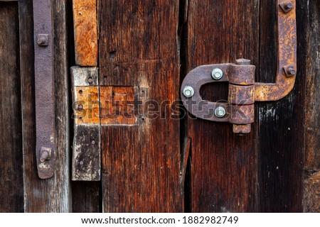 Rusty metal hinge, old gate Royalty-Free Stock Photo #1882982749