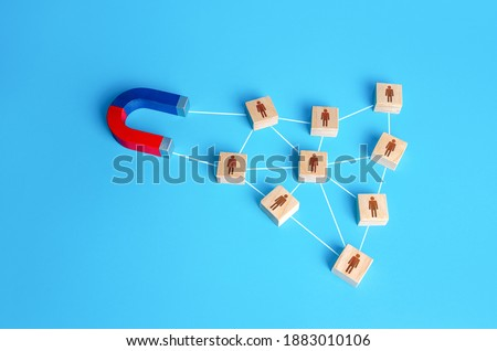 The magnet attracts a network of connected blocks of people. Attracting new customers based on recommendations and good reviews. Recruitment of entire formed teams of employees. Business team building Royalty-Free Stock Photo #1883010106