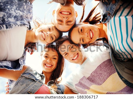 summer holidays and teenage concept - group of teenagers looking down #188306717