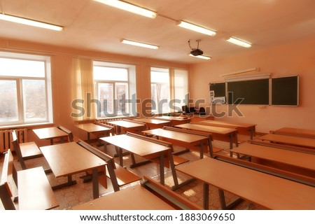 Interior of an empty school classroom. Concept of coronavirus COVID-19 quarantine in schools and educational institutions Royalty-Free Stock Photo #1883069650