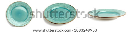 selective focus, A set of green turquoise round plates or dishes with a beautiful Golden outline, isolated on a white background with a clipping Royalty-Free Stock Photo #1883249953