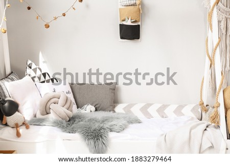 Comfortable bed in interior of children's room Royalty-Free Stock Photo #1883279464