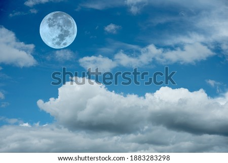Blue sky with clouds and full moon.