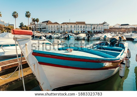 Old town of Faro with traditional wooden boat moored in marina, Algarve, Portugal Royalty-Free Stock Photo #1883323783