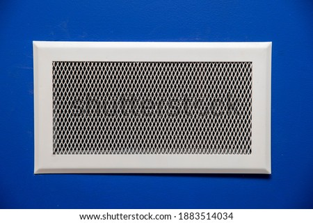 Hot air outlet grill of the central heating of the house.