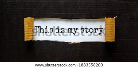 My story symbol. Words 'this is my story' appearing behind torn black paper. Beautiful background. Business and my story concept. Royalty-Free Stock Photo #1883558200