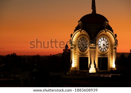 Sunset view of the historic clock tower in downtown Santa Ana, California, USA. Royalty-Free Stock Photo #1883608939