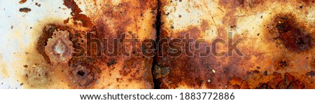 texture of rusty iron, cracked paint on an old metallic surface, sheet of rusty metal with cracked and flaky paint, corrosion, decay metal background, decay steel, decay Royalty-Free Stock Photo #1883772886